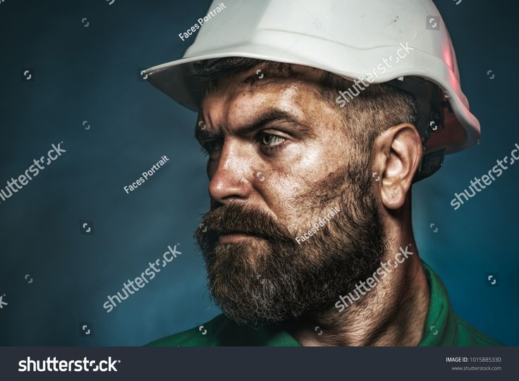 Business, building, industry, technology – builder concept. Business, building concept – builder in hard hat. Close up engineers working. Side view po…