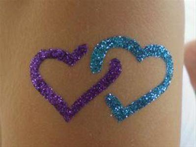 Purple And Blue Glitter Two Heart Tattoo Design