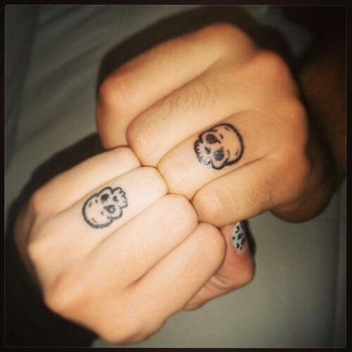 His n hers skull finger tattoos