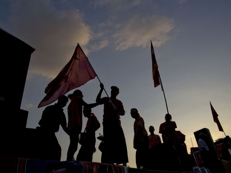 Supporters of Burma's opposition leader Aung San Suu Kyi's National League for Democracy Party decorate the back of a truck for a campaign rally in Rangoon, Burma.  Gemunu Amarasinghe, AP