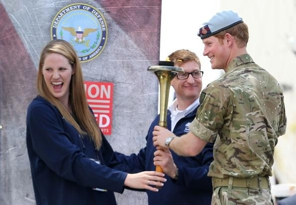 CAPTION THIS:  US Olympian Missy Franklin gets the giggles with Prince Harry