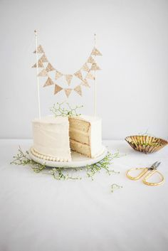 White Chocolate and Cinnamon Mascarpone Cake. Gold bunting flag cake topper.