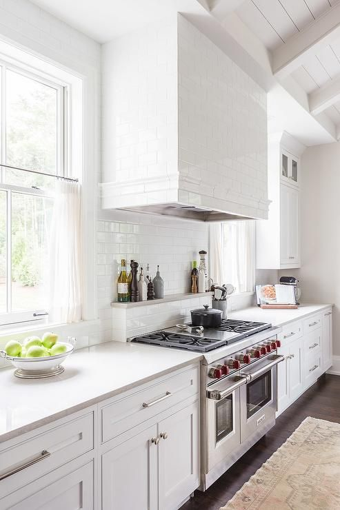 White Subway Tiled Kitchen Hood With Wolf Range Kitchen