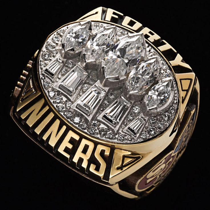 The Super Bowl XXIX San Francisco Forty Niners ring (by Balfour) features 5 large Marquis cut diamonds and 5 tapered baguettes along with pave diamonds.