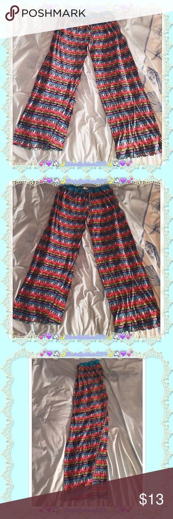 💕💚☮Peace, Love & Happiness Pajama Bottoms☮💚💕 💕💚☮American Basic ~ Peace * Love & Happiness Pajama Bottoms/Pants☮💚💕  💕💙Great deal!💖These👖petite pajama bottoms are in excellent pre-loved condition🌸VERY Slight fading but still lots of life left & SO cute for lounging around your humble abode👖🏡😻💐Super fun & colorful lightweight material with blue ruffled lining on bottom🤗Please View photos for best view of condition☺️💙💕   💚🌸Adorned with🙂Smiley Faces🙂, 💜Hearts💜 & ☮Peace…