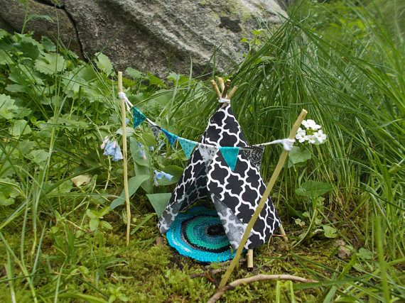 Miniature Fairy Garden Teepee 6 H. Such a unique addition to any indoor decor or outdoor fairy garden.  Raw cut fabric edges are part of the teepees charm. Fabric is lightly starched to help hold form, and edges have been treated to prevent fraying. The rug is crocheted with coordinating colors and finished with a scalloped edge. Banner has 7 flags, each with a different pattern and has been treated to hold form and avoid fraying.  Teepee is approximately 6 tall, Teepee Poles 7, Rug 4- 4…