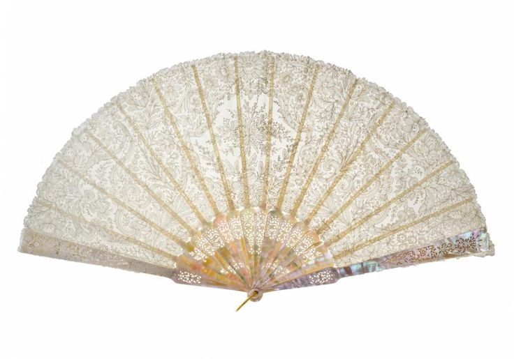 Folding fan with sticks and guards of carved and pierced mother-of-pearl, and leaf of white Brussels lace with a central motif and two side motifs in needle lace set in bobbin lace surround, the design floral, wedding fan of the donor's mother, part of the Richmond Inglis Collection: 1891