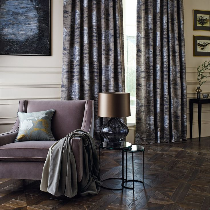 The soft opacity and flecks of gold leaf interlaced between layers of glass make the Fiametta lamp the perfect companion piece for these Moon Silk curtains from the new Edo fabric collection.