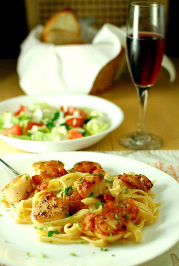 Seared scallops with garlicky pasta. Tasty seared scallops with a simple garlicky, white wine sauce. | joeshealthymeals.com