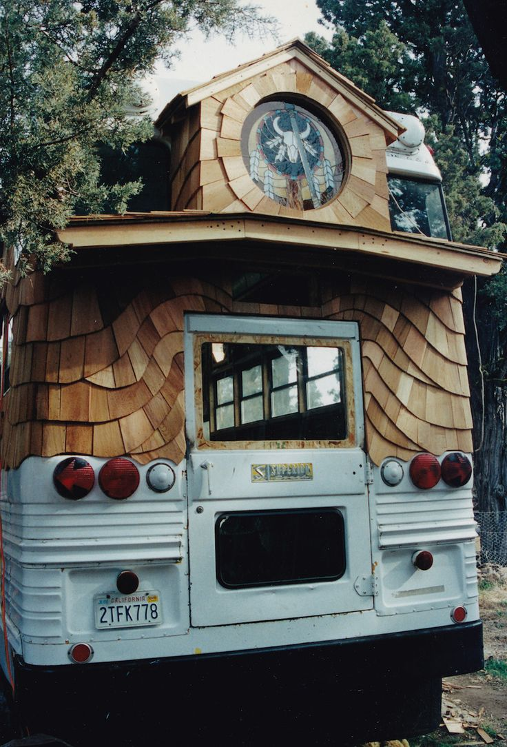"""I LOVE this quirky siding!  Plus, if you could work a round window into the tiny house design, we have a really neat phoenix stained glass window that Aaron made that would be nice to use.  It's about 14"""" in diameter. ------- school-bus-home-5"""