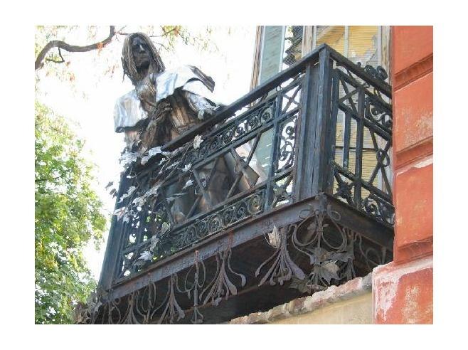 The statue on the balcony - Pecs, Hungary