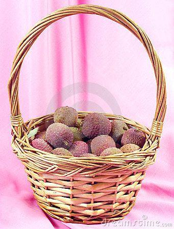 Whole fresh lychee in a wicker basket