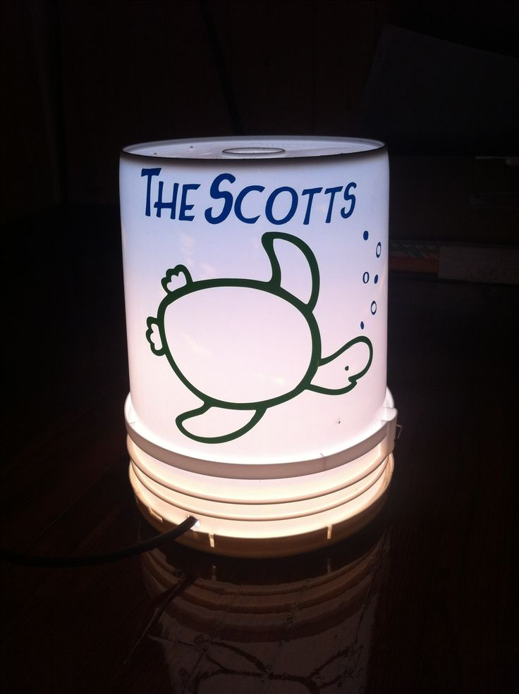 Camper light! 5 gallon bucket with light in it, our own light to find our camper at night! With Cricut decals on it!!