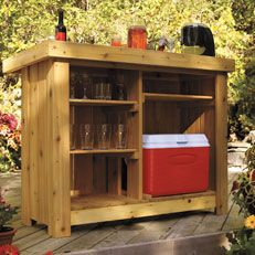 Have a beautiful place to serve guests drinks and hide away glassware and a cooler with a #DIY Cedar #Bar.