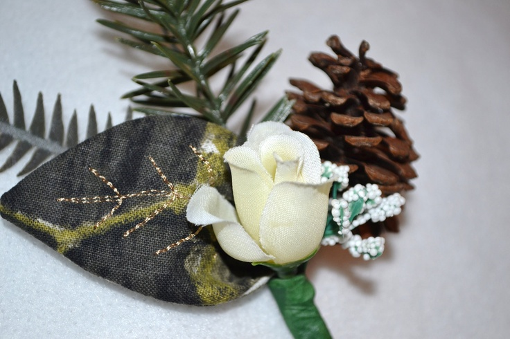 camo boutonniere - white rose and pine cone... any flower, plue acorns maybe??  Adds the rustic touch without losing all femininity or formality of occasion??