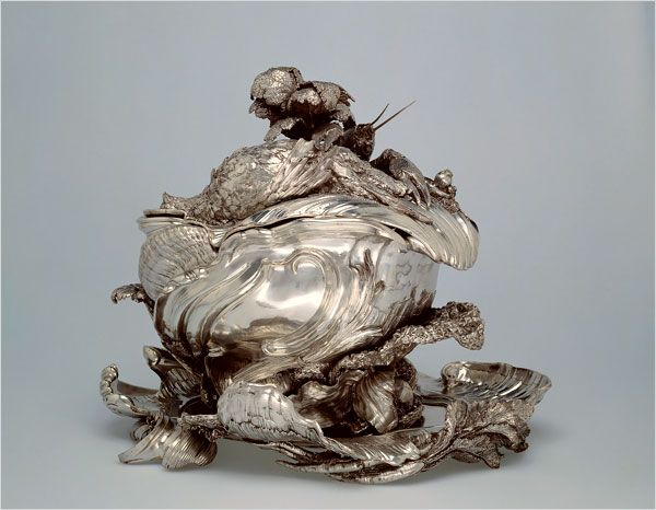 A great soup tureen made entirely of silver, it takes the form of a giant clamshell on whose fluted lid are piled the ingredients for a rich stew.     This amazing culinary showpiece was made between 1735 and 1740 by craftsmen under the direction of Juste-Aurèle Meissonier, the French designer who is considered the father of the Rococo.