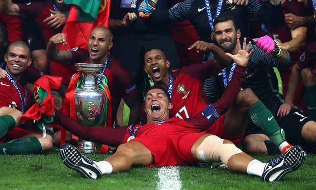 Cristiano Ronaldo and his Portugal team-mates celebrate with the European Championship trophy after their 1-0 win against France.