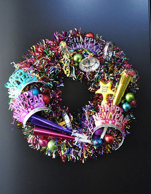 New Years Eve Wreath.  No instructions but I think with a colorful garland and New Years Eve trinkets you can recreate this.  From: creative sparks