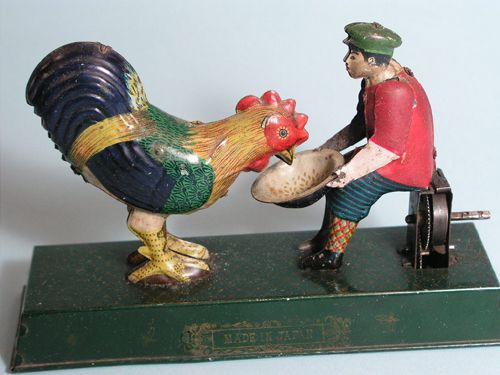 German tin - feeding rooster.  German penny toys are the best!