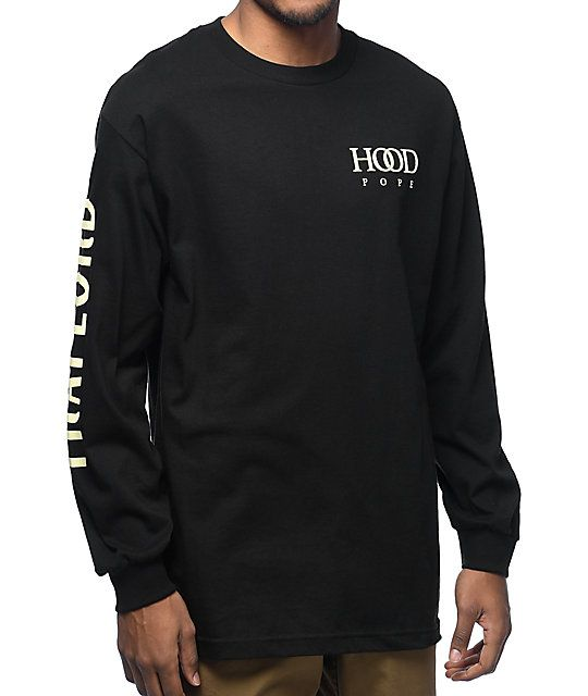 "The Hood Pope long sleeve tee from Trap Lord features the ""Hood Pope"" screen print at the left chest while ""Trap Lord"" is printed down the right sleeve both written in cream on a black, 100% cotton shirt."