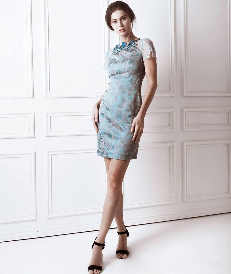Lovato Dress    Lovato dress is crafted from the finest soft jacquard. The shift dress features elegant lace sleeves. Sophistication at its finest.