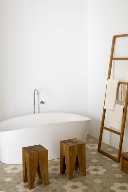 perfect ladder for this design bath to hold towels within reach while sitting in the tub