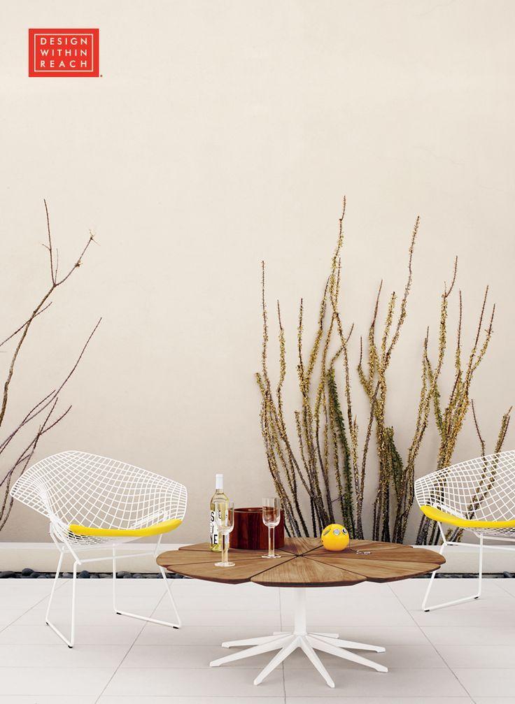 Bertoia Diamond Lounge Chair with Yellow Seat Pad designed by Harry Bertoia.
