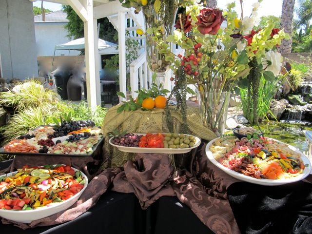 Party buffet table decorating ideas on the patio for Patio table centerpiece ideas