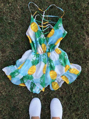 This sweet pineapple romper adds some serious edge with a plunging neckline, a detailed strappy back, and a ruffled bottom. Fully lined. FABRIC: 97% cotton 3% elastane FIT: true to size CARE: machine