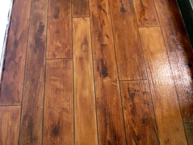 Rustic concrete stamped to look like wood high demand for Hardwood floor finishes