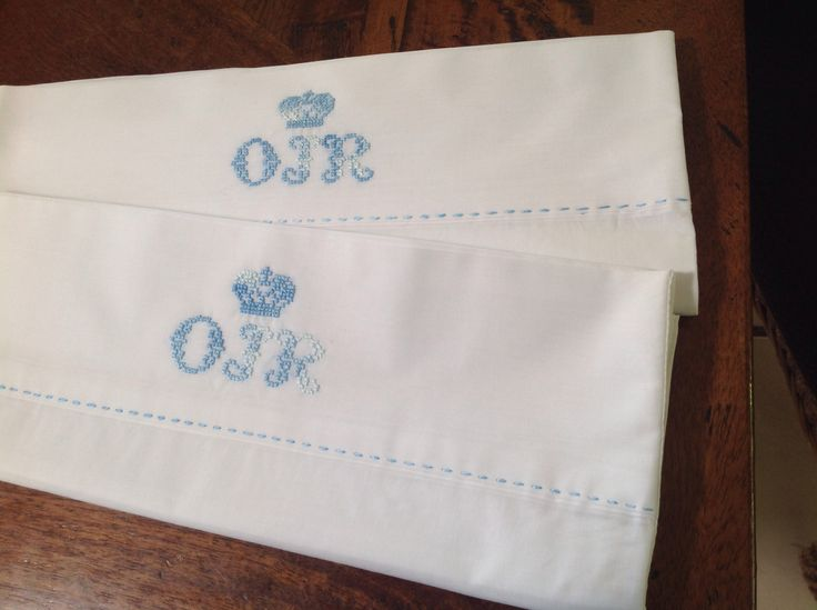 Monogrammed cross stitched baby pillow cases using variegated stranded yarn.