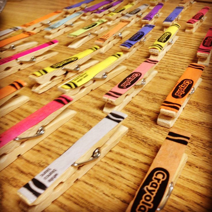 Modge podge crayon wrappers onto clothespins for classroom decoration.