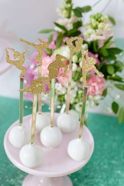 Gold toppers on cake pops at a gymnastics birthday party! See more party planning ideas at CatchMyParty.com!