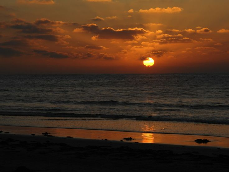 Amazing shot of sunset on the beach taken from this spacious Torquay holiday house