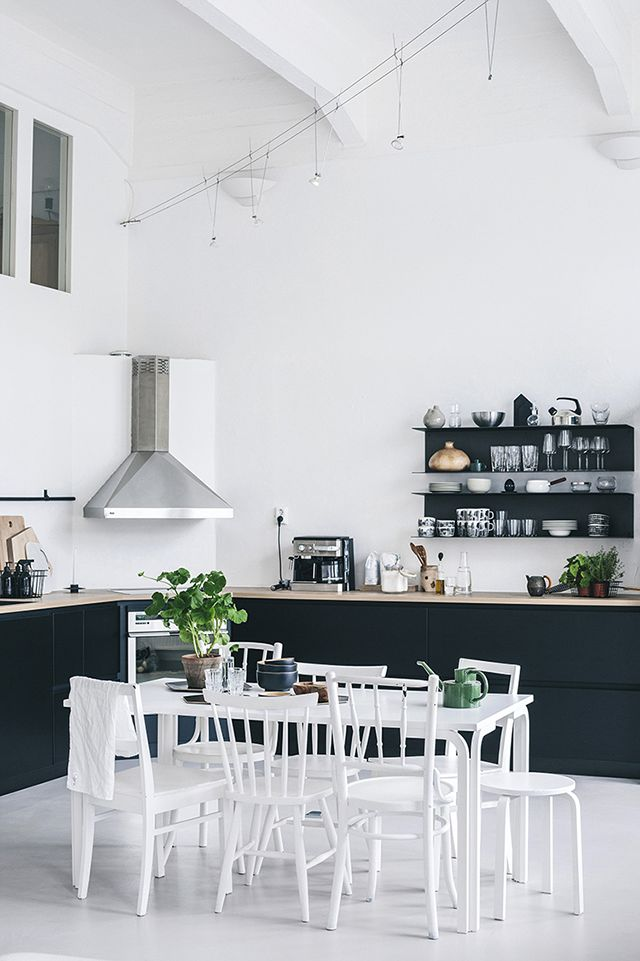 monochrome kitchen and dining. absolutely in love with the open shelving and lack of upper cabinets.