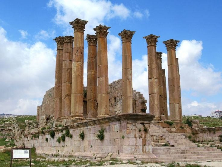 The massive columns of the Temple of Artemis at Jerash, Jordan, sway slightly in the wind. Artemis was the patron goddess of the ancient Roman city of Gerasa.