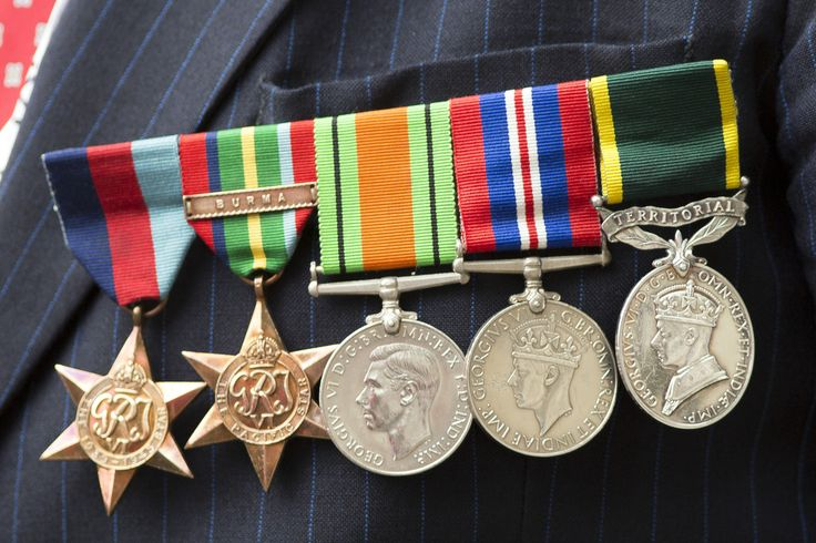 Detail of a veteran's medals as they process down Whitehall past a statue of…