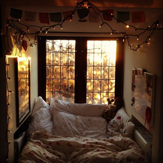 How I love a bed in a nook with a window! Imagine the naps you could have there.