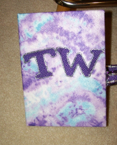 This is a DVD video case I made for my daughters allstar cheerleading videos.  It was actually a picture photo album that i recovered with huge piece of felt bought at Hobby Lobby (hot glued down).  The lettering was made with my fabric cut out from my cricut.  The outline was fabric paint.  :)   Good way to keep all the cheer videos organized!!!