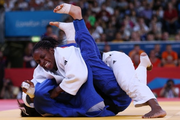 LONDON, ENGLAND - JULY 31: Gevrise Emane of France (white) competes with Da-Woon Joung of Korea in the Women's -63 kg Judo on Day 4 of the London 2012 Olympic Games at ExCeL on July 31, 2012 in London, England. (Photo by Quinn Rooney/Getty Images)