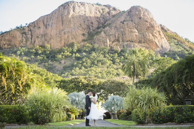 A beautiful bride and groom at Queens Gardens in the shade of Castle Hill in Townsville, North Queensland