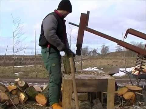 wood splitter with car spring to prevent splitter from reaching table. Axe head weighs about 20 lbs