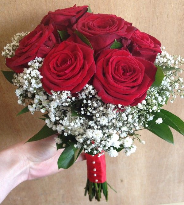 Romantic red roses spell LOVE! Red Rose and Gypsophilia Brides Hand Tied Bouquet shown from the side. Liverpool, UK.