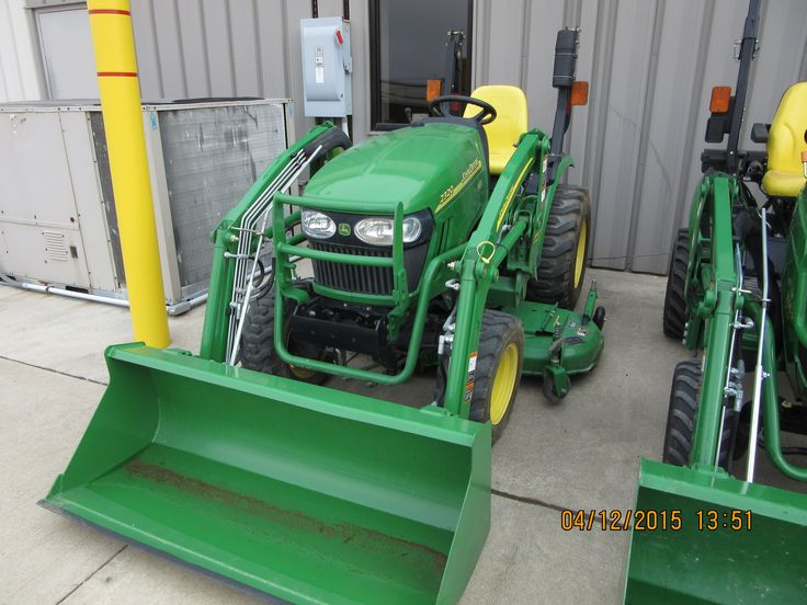 John Deere 2320 equipped with 200CX loader