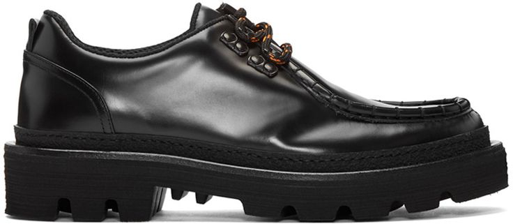 Buffed leather shoes in black. Stitched accent at round moc toe. Lace-up closure…