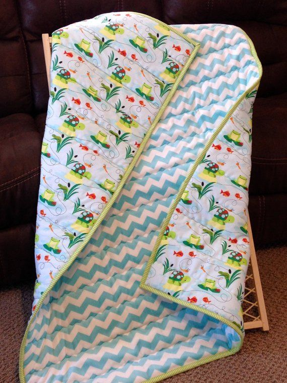 Quilted Baby Crib Blanket with light Batting and yellow flannel backing.