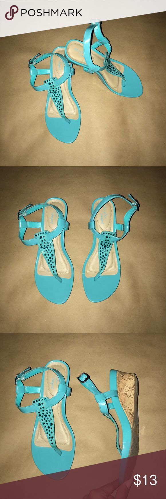 "Dexflex Comfort; Teal Wedged Sandals, Size 6.5 -From the brand Dexflex Comfort. -Size 6 1/2. Approximate measurements: •Length: 9"" •Width: 3"" •Heel: 2 1/8"" -Teal shade. -Buckle at the sides. -No flaws! Dexflex Comfort Shoes Wedges"