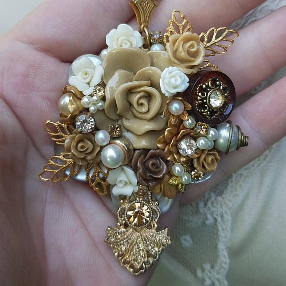 Mini assemblage pendants made from responsibly repurposed broken vintage jewelry, ceramic flowers, polymer clay flowers, Russian Goldplate leaves and roses, vintage crystals, Swarovski crystals, vintage buttons , undrilled faux pearls and other bits and bobs. These were so much fun to