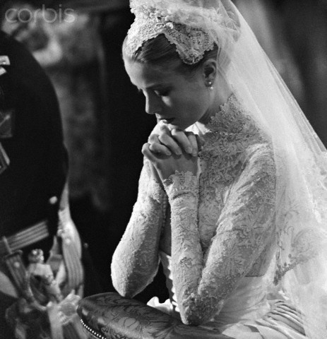 Grace's wedding gown was a gift from the MGM Studio and designed by Helen Rose. It was a high-necked, long-sleeved gown with a fitted torso and billowing skirt made of twenty-five yards of silk taffeta, one hundred yards of silk net, peau-de-soie, tulle and 125-year-old Brussels rose point lace. She wore a Juliet cap that was decorated with seed pearls, orange blossoms, and a veil of 90 yards of tulle. Grace carried a small Bible and a bouquet of lilies-of-the-valley.