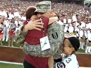 Military dad surprises kids, wife at football game - Video on TODAY.com